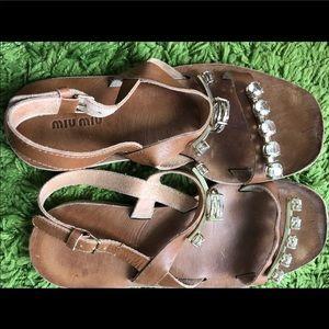 Prada sandals.